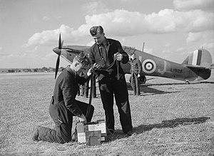 Alois Vašátko - Armourers of 312 Squadron prepare ammunition belts, with Vašátko's Hurricane Mk I fighter, DU-J, in the background
