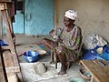 An Ilorin potter preparing her clay.jpg