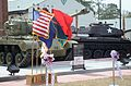 An M26 Pershing medium tank appears behind a ribbon before the start of a ceremony marking the reopening of the U.S. Army Basic Combat Training Museum at Fort Jackson, S.C., April 3, 2013 130403-A-SO744-052.jpg