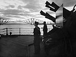 An eight-barrelled two-pounder 'pom-pom' gun on HMS RODNEY silhouetted at sunset in the Firth of Forth, October 1940. A1208.jpg