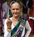 An elderly women voter showing mark of indelible ink after casting her vote, at a polling booth, during the first phase of Assam Assembly Election, at Chamuapara TE, under Udalguri District on April 04, 2016.jpg
