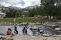 At Breckenridge, Colorado's Blue River Plaza, residents and visitors enjoy the river of the same name near what was once the site of old gold mines. The piece of a building to the left belongs to the LCCN2015633655.tif