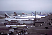 Larger planes lined up at a terminal