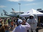 Baby In Space Suit In Front Of Space Shuttle Endeavour.JPG