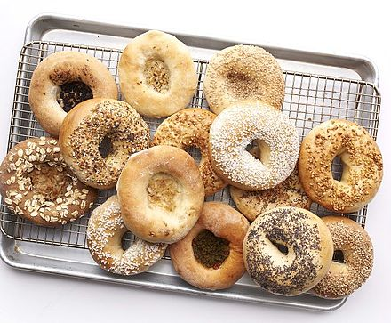 Bagels, made from yeasted wheat dough, originated in Poland. Bagel Bialy.JPG