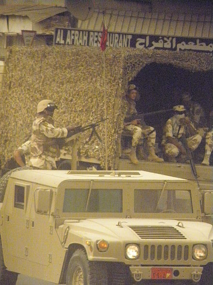 Bahrain army forces at a village entrance on 29 March Bahrain army in a village.JPG