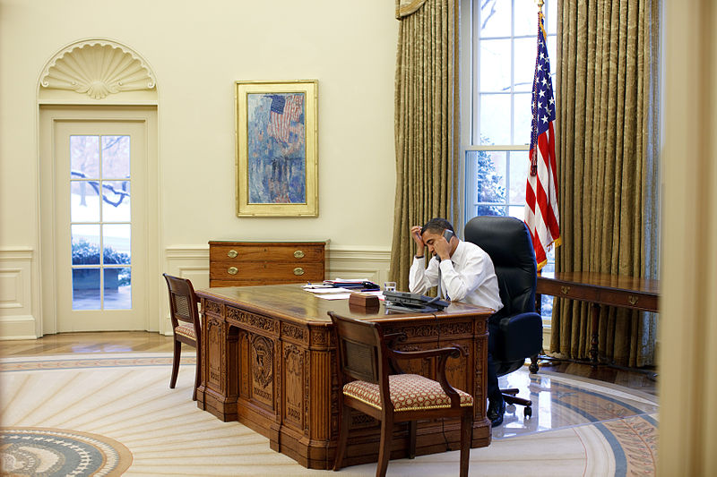 File:Barack Obama working at his desk in the Oval Office.jpg