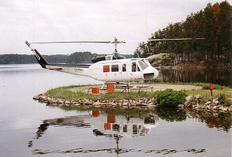 Bell 204/205 - A Bell 205A-1 on firefighting duty with the Ontario Ministry of Natural Resources at Nym Lake, ON, 1996