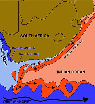 "Cape Peninsula - The courses of the  warm Agulhas current (red) along the east coast of South Africa, and the cold Benguela current (blue) along the west coast. Note that the Benguela current does not originate from Antarctic waters in the South Atlantic Ocean, but from upwelling of water from the cold depths of the Atlantic Ocean against the west coast of the continent. The two currents do not ""meet"" anywhere along the south coast of Africa."