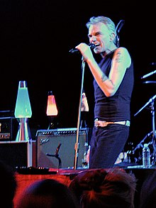 Billy Bob Thornton standing, singing into a microphone