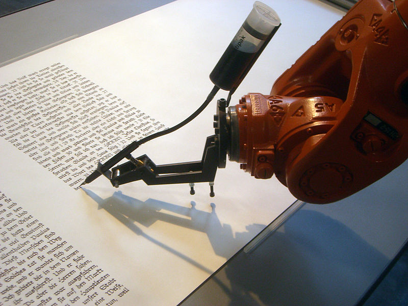 The installation 'bios [bible]' consists of an industrial robot, which writes down the bible on rolls of paper. The machine draws the calligraphic lines with high precision. Like a monk in the scriptorium it creates step by step the text.