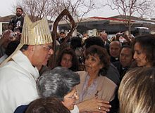 Bishop Richard Garcia greets his guests.jpg