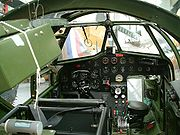 Blenheim Mk. IV cockpit. Note the asymmetry of the instrument console, indicating the position of the scooped out area of the nose in front of the pilot. The ring and bead gunsight for the forward firing guns is visible.