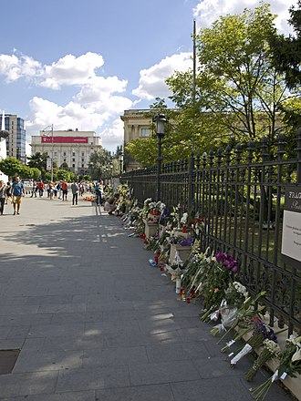 Queen Anne of Romania - Flowers and candles in front of the fence of the former Royal Palace in Bucharest on 13 August 2016