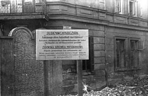 Józef Adamowicz - Warning sign at the outside wall of Kraków Ghetto (1939–45)
