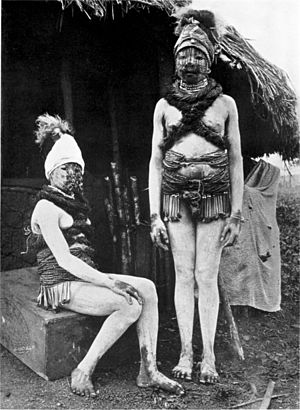 """Adornment - The principal adornment of these girls from the Bundu tribe in Sierra Leone is the adornment of bodies and faces with markings produced by the smearing on by the fingers of a substance called """"wojeh,"""" composed of white clay and animal fat."""