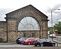 Buxton railway station, L&NWR arch, Derbyshire.jpg
