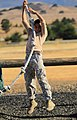 Cadet 1st Class Manuel Lozano, a junior at Riverside County Education Academy (RCEA), swings from a rope.jpg