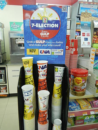 2013 Philippine general election - 7-Eleven in Baliuag, Bulacan, offering customers a chance to show support for a coalition.