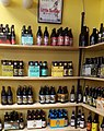 Capital District tourism gnome buys beer at Pint Sized on Lark St (34158180073).jpg