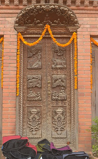 Buddhist mythology - Carved door with Buddha life scenes, Nepal