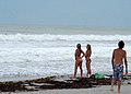 Checking the waves (3880243648).jpg