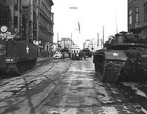 Soviet tanks face U.S. tanks at Checkpoint Charlie, 1961-10-27