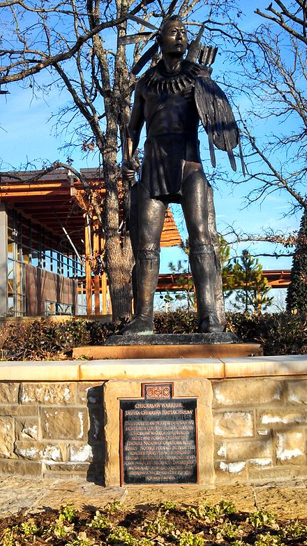 Sculpture of a stylized 18th-century Chickasaw warrior by Enoch Kelly Haney, at the Chickasaw Cultural Center in Oklahoma Chickasaw cultural center 1.jpg