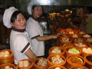 Dim sum - Dim sum dishes being prepared in a restaurant in Beijing.
