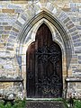Church of St Andrew, Nuthurst, West Sussex - nave west door.jpg