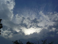 A picture showing the cirrus clouds lancing out from the anvil of the thunderstorm. Picture taken just before the lower mass of the cumulonimbus cloud went over the photographer.