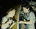 Close detail, Riveters at work on fuselage of Liberator Bomber1a34927v (cropped).jpg