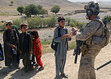 United states navy seals resource learn about share and discuss a us navy seal assigned to special operations task force south east greets children in a village in uruzgan province 30 august 2012 fandeluxe Gallery