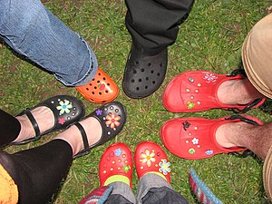 Crocs - Various types of Crocs with accessories.