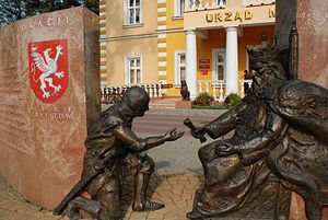 Dębica - Monument depicting Kazimierz Wielki giving Świętosław Gryfita permission to create Dębica