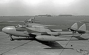 Hawarden Airport - Newly-built DH Venom and Vampire aircraft at Chester in 1953 with 48 MU hangars in the background
