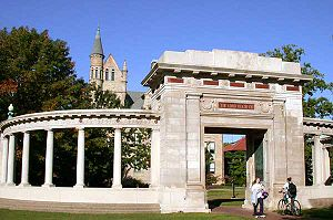 Students passing through the Memorial Arch in front of Peters Hall. The arch is dedicated to the memory of missionaries from Oberlin who were killed in the Boxer Rebellion.
