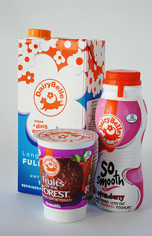 Dairy product - A selection of three common dairy products made by a South African dairy company: a box of full cream, long life milk, a bottle of strawberry drinking yogurt, and a carton of passion fruit yogurt