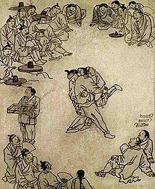 "The painting titled ""Sangbak"" (상박 相撲) drawn by Kim, Hongdo illustrates people gathering around to watch a ssireum competition in the late 18th century."