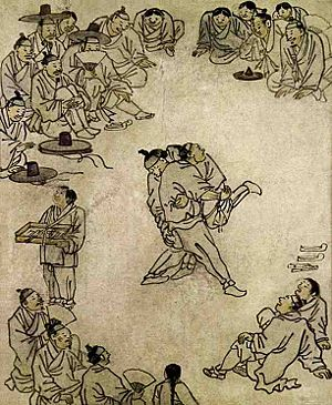 "Ssireum - The painting titled ""Sangbak"" (상박; 相撲) drawn by Kim Hong-do illustrates people gathering around to watch a ssireum competition in the late 18th century."