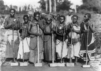 Penal labour - Female convicts chained together by their necks for work on a road. Dar es Salaam, Tanganyika c.1890–1927.