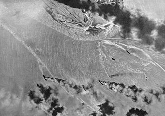 Bombing of Darwin - An aerial photograph of vessels burning in Darwin Harbour taken by a Japanese airman during the first raid.