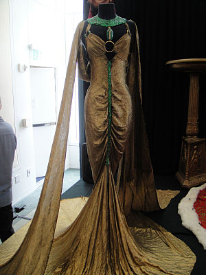Lamé (fabric) - Gold-lamé and emerald royal boudoir gown from the film ''Cleopatra'' (1934)