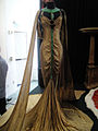"Debbie Reynolds Auction - Claudette Colbert gold-lame and emerald royal boudoir gown from ""Cleopatra"" (1934) (5851926969).jpg"