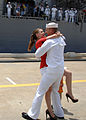 Defense.gov News Photo 110715-N-YF783-062 - Petty Officer 2nd Class Warren Benjamin receives the traditional first kiss from his wife during a homecoming celebration for the guided-missile.jpg