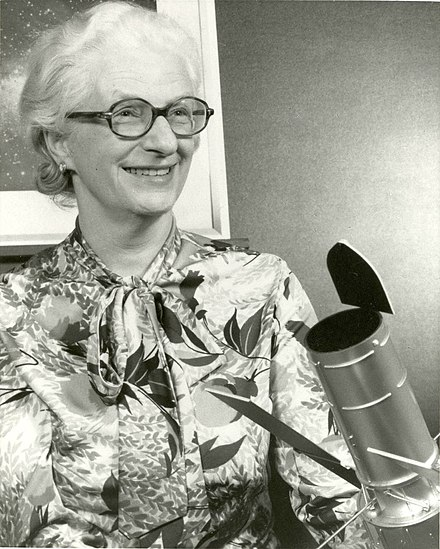 Dr. Nancy Grace Roman with a model of the Large Space Telescope that was eventually developed as the Hubble Space Telescope. While listed as a 1966 photo, this design was not the standard until the mid-1970s. DrNancyGraceRoman2.jpg