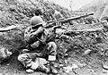 Dutch soldier returns sniper fire in Korea-1952.jpg