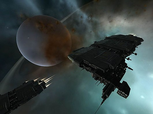 "Two freight haulers called ""Charons,"" a kind of ship introduced in the ""Red Moon Rising"" content patch EVE Online - Caldari Freighters.jpg"