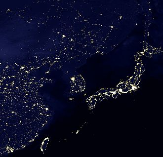 City - A satellite view of East Asia at night shows urbanization as illumination. Here the Taiheiyō Belt, which includes Tokyo, demonstrates how megalopolises can produce light pollution.