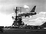 F8U-1E Crusader of VF-154 over USS Coral Sea (CVA-43) on 4 March 1961 (NNAM.1996.253.7350.008).jpg